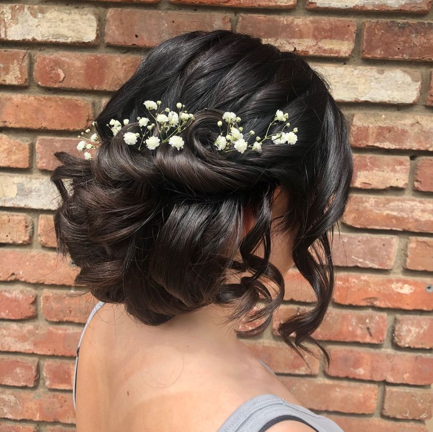 updo with baby's breath and curls