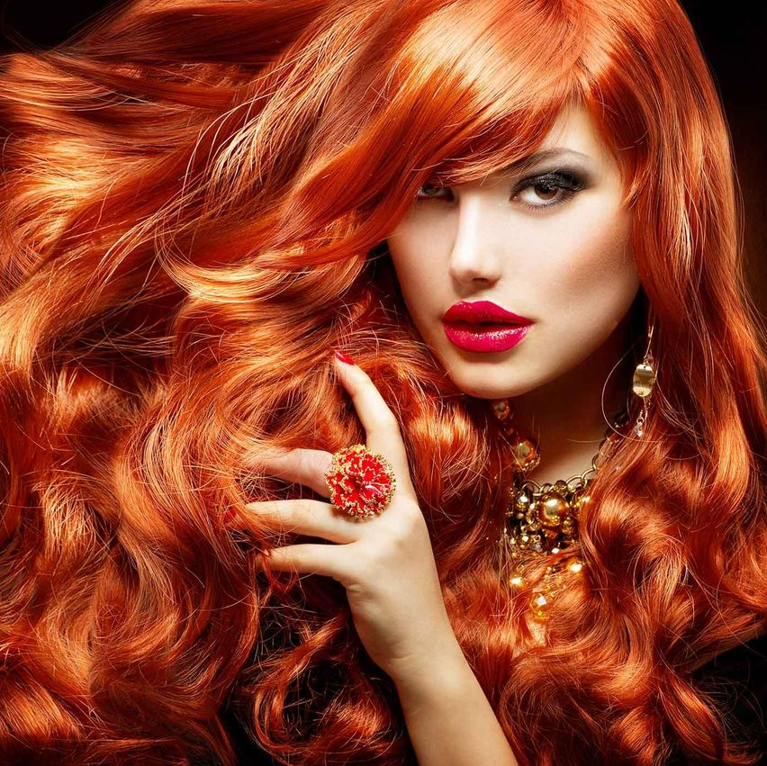 lady with beautiful red hair and funky ring